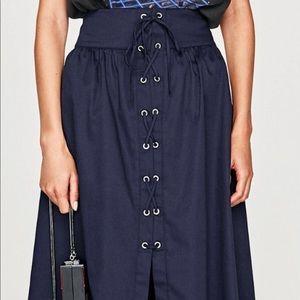 Zara. Skirt with metal grommets
